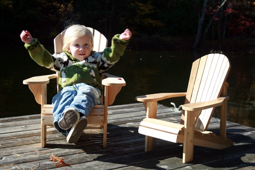 Kid Sitting in Adirondack Chair