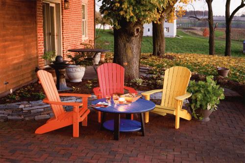 Three Colored Adirondack Chairs