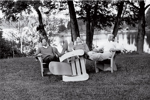 Mens Sitting on Adirondack Chairs