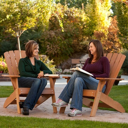 Two Women Sitting on Adirondack Chair