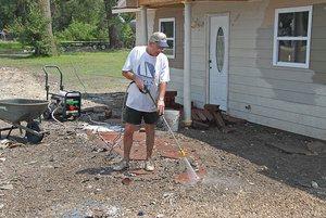 FEMA_-_30619_-_Man_cleaning_sidewalk_in_Missouri_with_pressure_washer