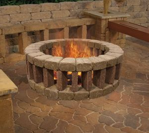Colosseum-In-Patio-Inspiration-Unconventional-Shape-Game-of-Stones-Backyard-Getaway-Not-The-Center-of-Attention- Inground Fire Pit